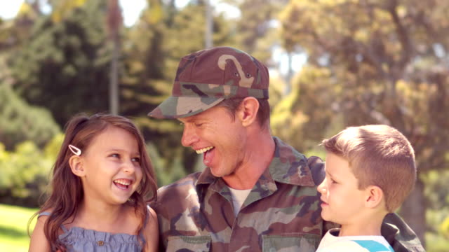 Handsome soldier reunited with his children video