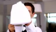 Handsome waiter polishing wine glass video