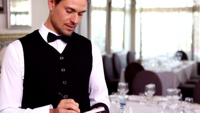 Handsome waiter taking an order video