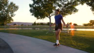 Handsome Young Athletic Man Jumping Rope in Park at Dusk video