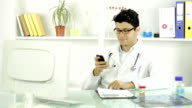 Handsome Young Doctor Texting Smiling Cellphone video