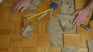 Handyman Removing Damaged Parquet video
