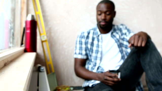 Handyman Sitting Drinking from Flask video