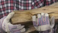 handyman with oak logs in the arms video