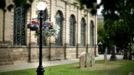 Hanging flower basket outside St Philip's Cathedral, Birmingham. video