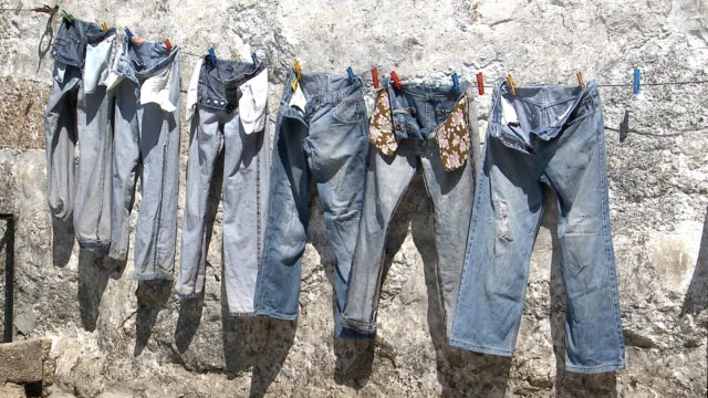 Hanging jeans pants drying video