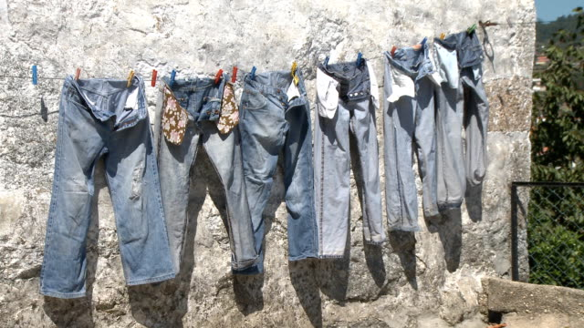 Hanging jeans trousers drying video