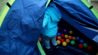 Happiness girl playing in tent with her friend video
