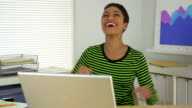 Happy African American business woman celebrating in office video
