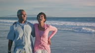 Happy African American Couple walk on the Beach video