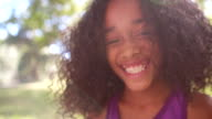 Happy Afro girl laughing playfully in a park video
