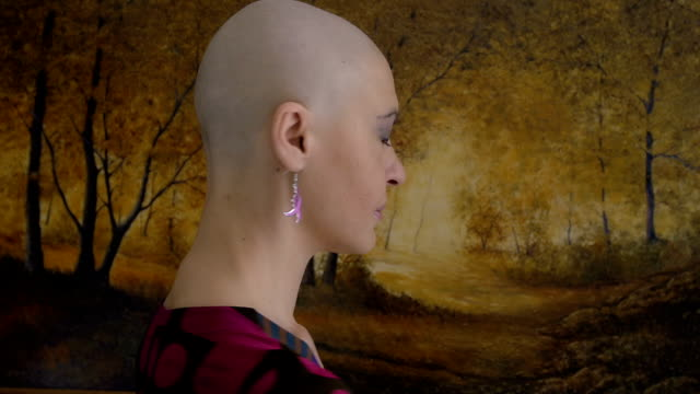 Happy and young cancer survivor after successful chemotherapy: courage, hope video