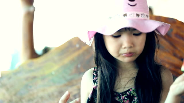 Happy Asian child enjoy eating ripe watermelon . video