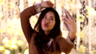 Happy asian woman taking selfie joyful and happy smiling at night video