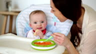 Happy Baby Being Fed by Mother video