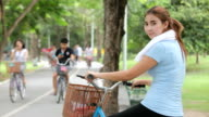 Happy beautiful young asian woman with bicycle video