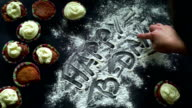 Happy birthday writing on white flour. Finger writing. Inscription 'Happy b-day' video