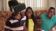 Happy Black Family Playing With Virtual Reality Goggles VR Headset video