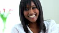 Happy black woman looking at camera video