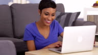 Happy black woman surfing the internet video
