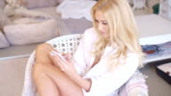 Happy Blond Teen Woman on Chair Busy with Phone video