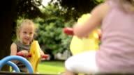 Happy blonde children on hobbyhorse outdoor video HD video