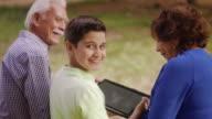 Happy Boy Studying School Homework With Grandparents video