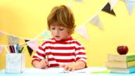 Happy boy using a paint brush video