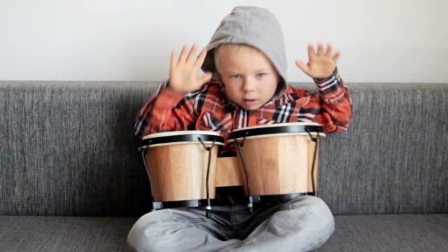 Happy boy with bongos video