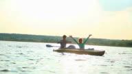 Happy boyfriend girlfriend enjoying boat ride, relaxation, water video