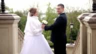Happy bride and groom posing video