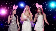 Happy bride with girlfriends dancing drinking champagne  at bachelorette party video