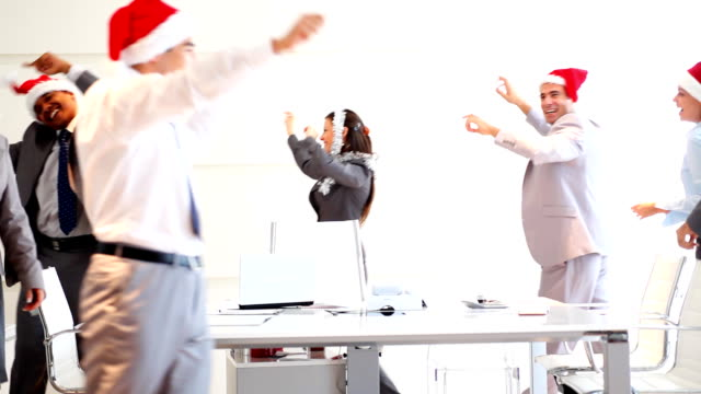 Happy business people with Santa hats celebrating Christmas. video