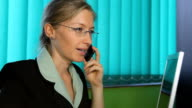 Happy business woman at office, callphone, mobilephone, corporate video