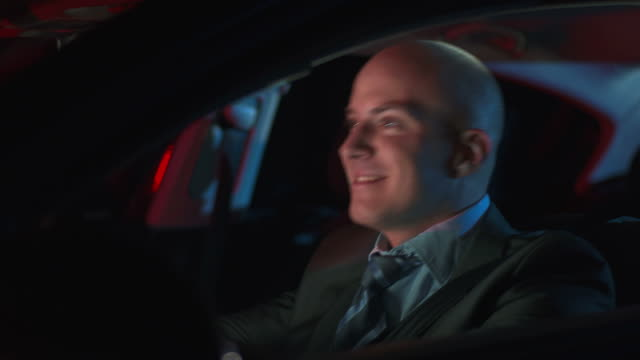 HD DOLLY: Happy Businessman Driving At Night video