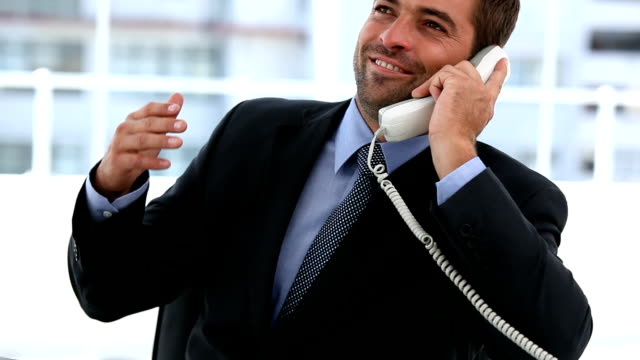 Happy businessman on the phone video