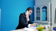 Happy businessman talking on the phone video