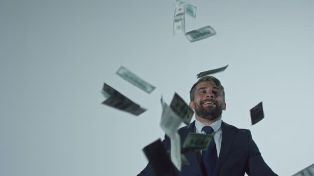 Happy Businessman Throwing Money in Air video