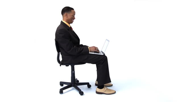 Happy businessman with laptop in chair video