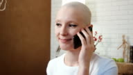 Happy cancer survivor woman talking on the phone video