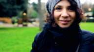 Happy casual woman with hat walking in autumn park video