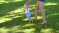 Happy Child Making First Steps in a Park video