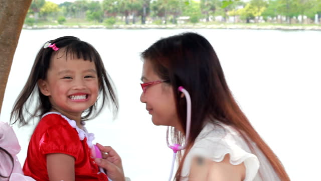 Happy child playing with the mother at park video