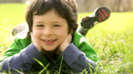 Happy child smiling outdoor video HD video