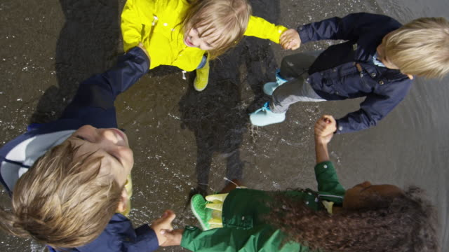Happy Children Playing in Puddle video