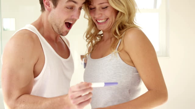 Happy couple discover the pregnancy test video