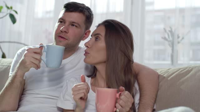 Happy Couple Drinking Tea on Sofa video