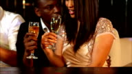 happy couple holding champagne video