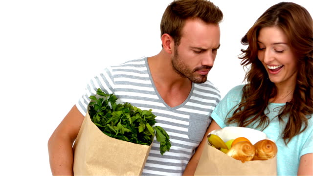 Happy couple holding grocery bags video