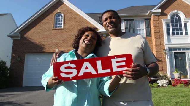 Happy Couple Holding SALE Sign video